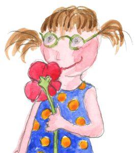 Tyttö haistaa kädessään olevaa punaista kukkaa.